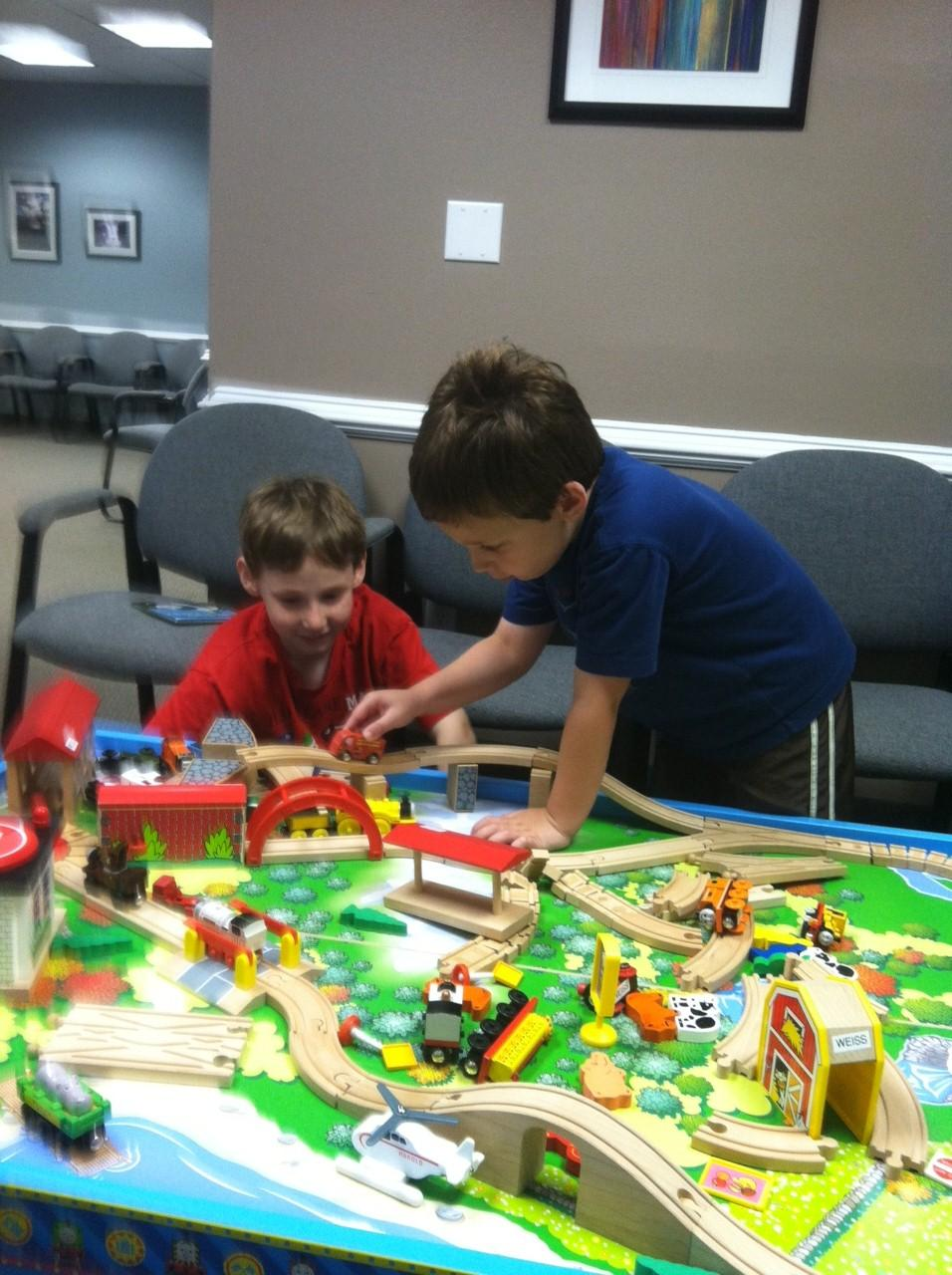 Jason and Ryan playing with trains