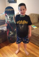 Ryan shows off his Mouseheart T-shirt and Skate Deck